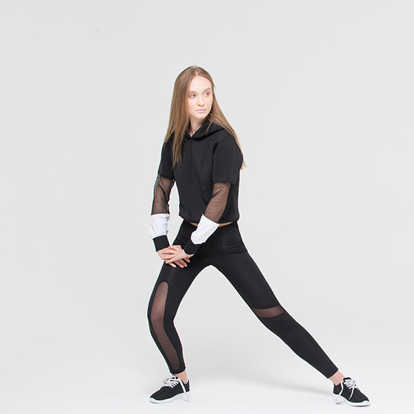 A woman wears Ryder act branded compressive mesh leggings at hippist
