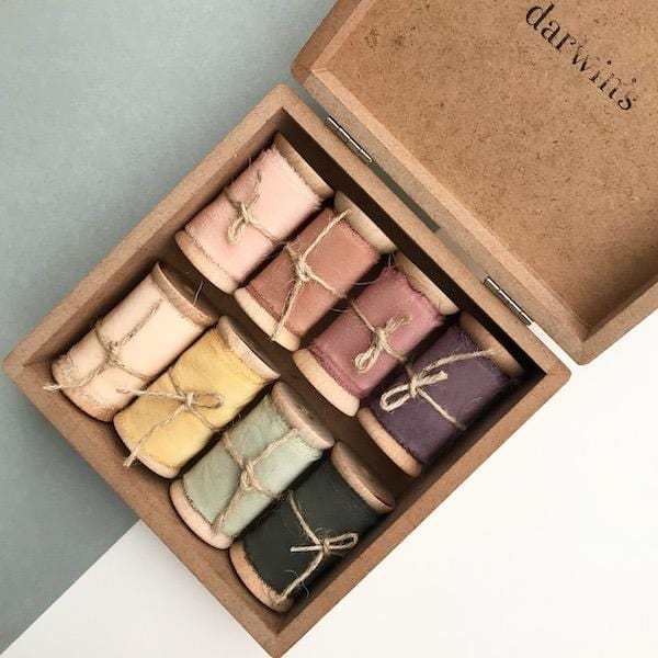8 different colours silk ribbon in a wooden box