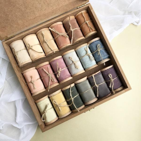 18 different colours silk ribbons in a wooden box