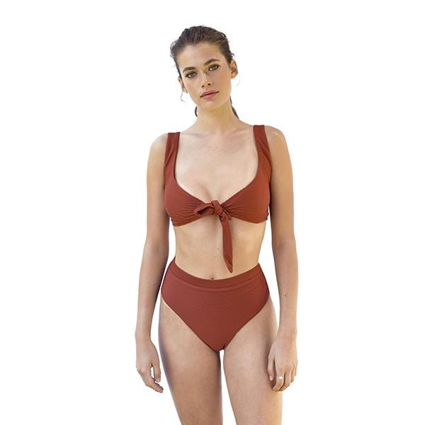 A woman with Movom branded tie front reddish brown bikini