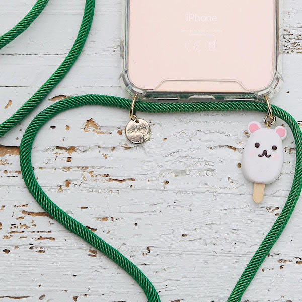Zoey branded phone cover with green fun phone strap and fun bear charm at hippist.co.uk