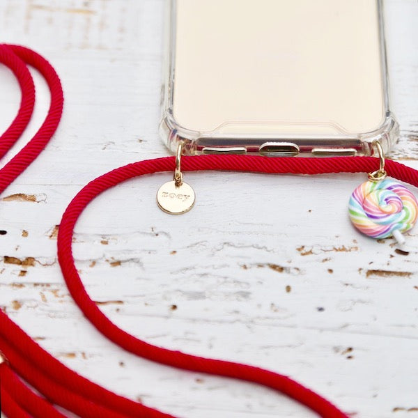 Zoey branded phone cover with red fun phone strap and fun candy charm at hippist.co.uk