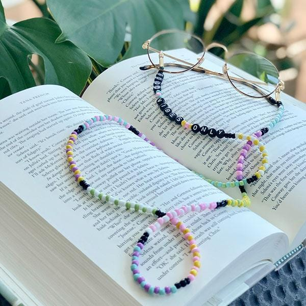 colourful beaded handmade eyeglass chain on the book