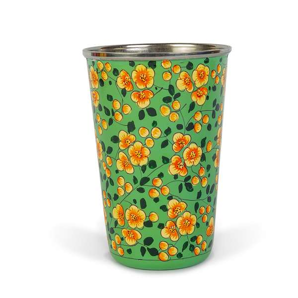 Green enamelware tumbler with yellow flowers