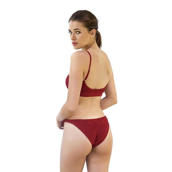 A woman with Movom branded red wine smock bikini
