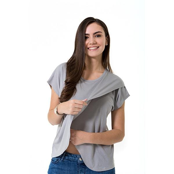 A woman with Accouchée branded grey nursing blouse