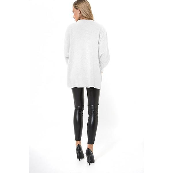 A woman with Accouchée branded white knitwear nursing sweatshirt