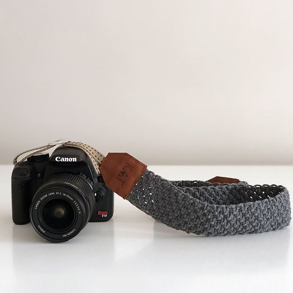 A analog zenit camera with grey macrame handcrafted camera strap