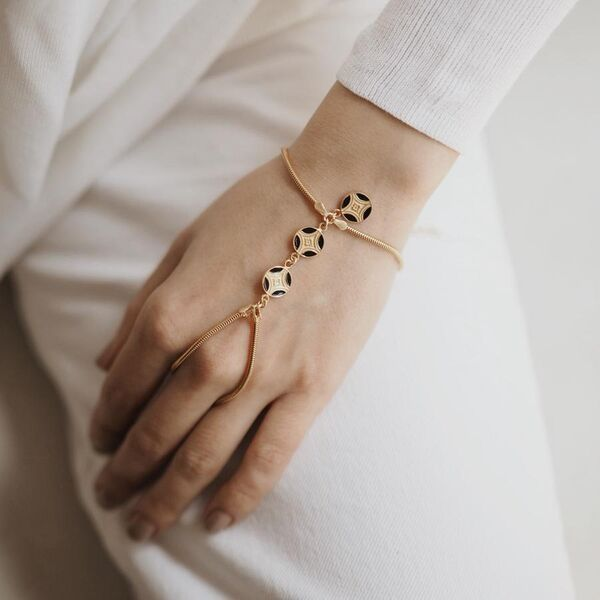 A woman with A woman with 925 sterling silver, enamel gold-plated handcrafted finger bracelet