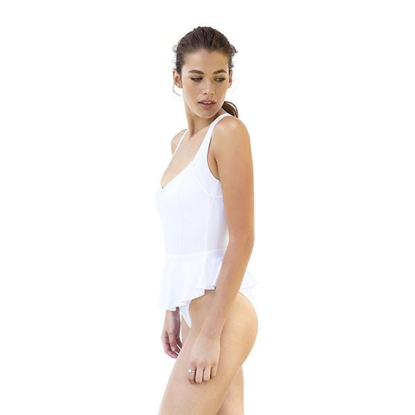 a woman with v-neck skirted movom branded white swimsuit