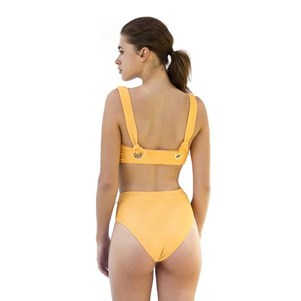 A woman with Movom branded tie front yellow bikini
