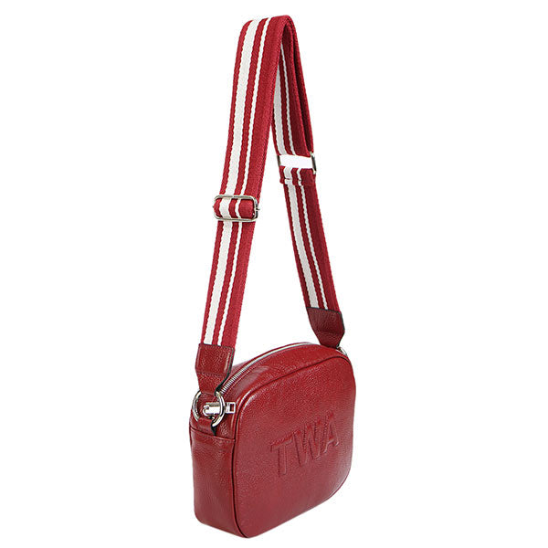 premium leather red colour shoulder bag with red and white strap at hippist