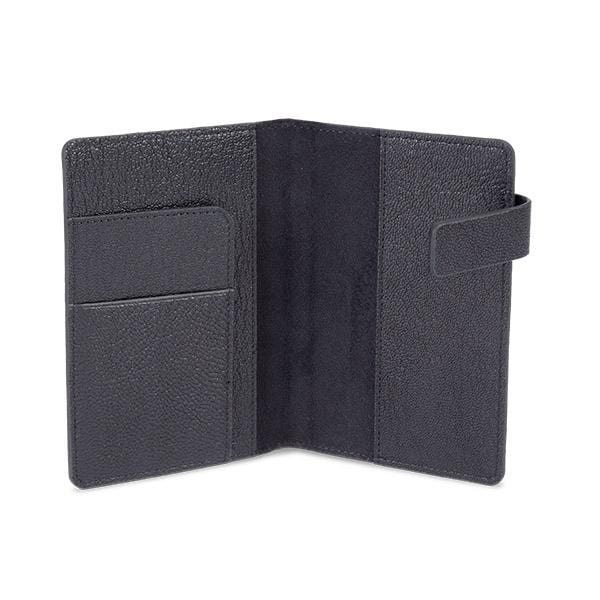 black colour passport sleeve manufactured from lamb leather with its magnet cover detail.