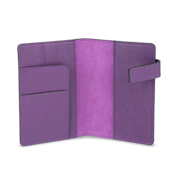 purple colour passport sleeve manufactured from lamb leather with its magnet cover detail.