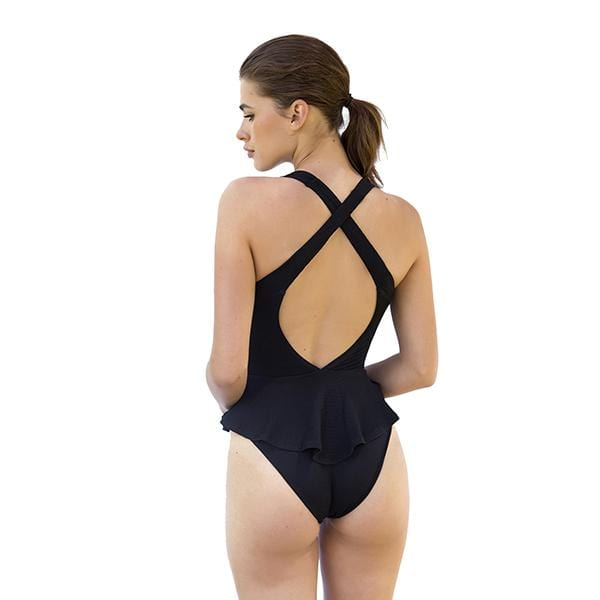 a woman with v-neck skirted movom branded black swimsuit
