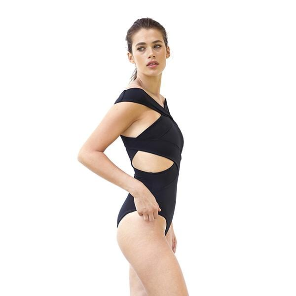 a woman with banded cross top movom branded black swimsuit