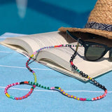 colourful beaded handmade 35 inch stay in the magic  eyeglass chain on the book