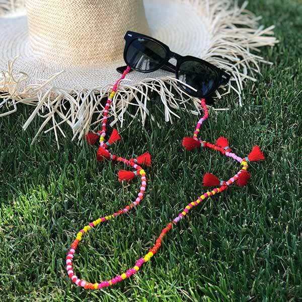 colourful beaded handmade 35 inch strawberry lemonade sunglass chain near the straw hat