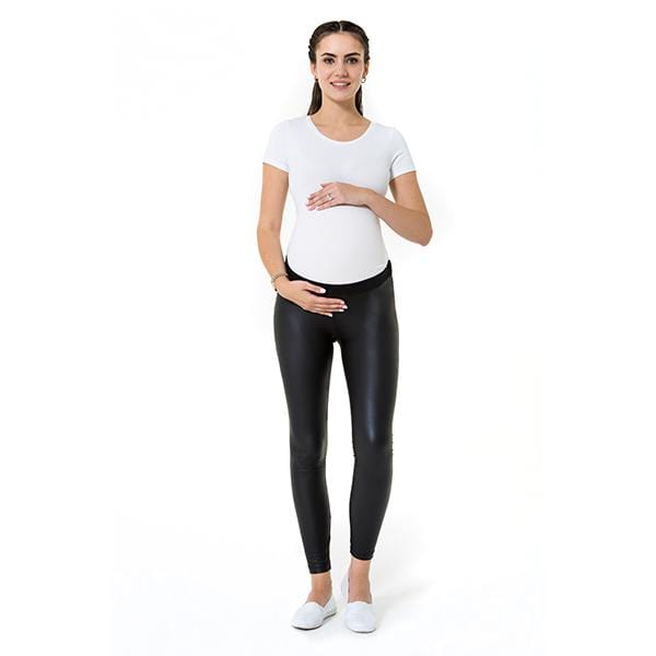 A pregnant woman wears subtle high black low rise maternity legging and white t-shirt