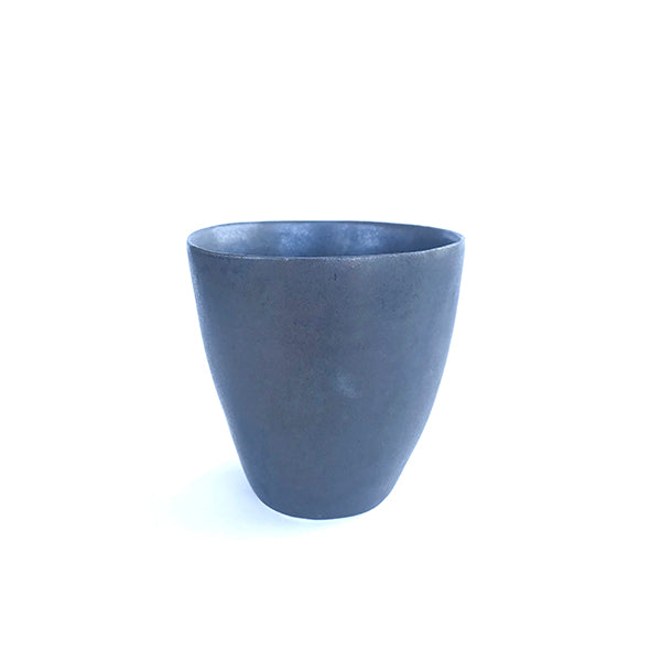 handmade ceramic black colour tea and coffee cup or water cup at hippist