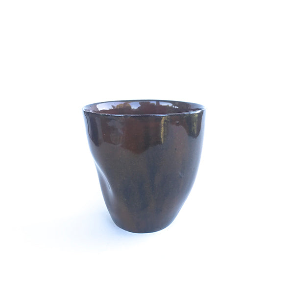 handmade ceramic brown colour tea and coffee cup or water cup at hippist
