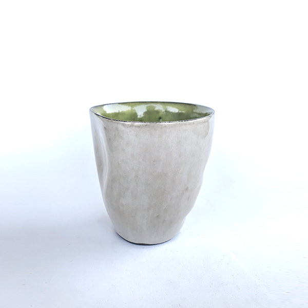 handmade ceramic green latte colour tea and coffee cup or water cup at hippist
