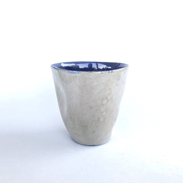 handmade ceramic latte navy colour tea and coffee cup or water cup at hippist