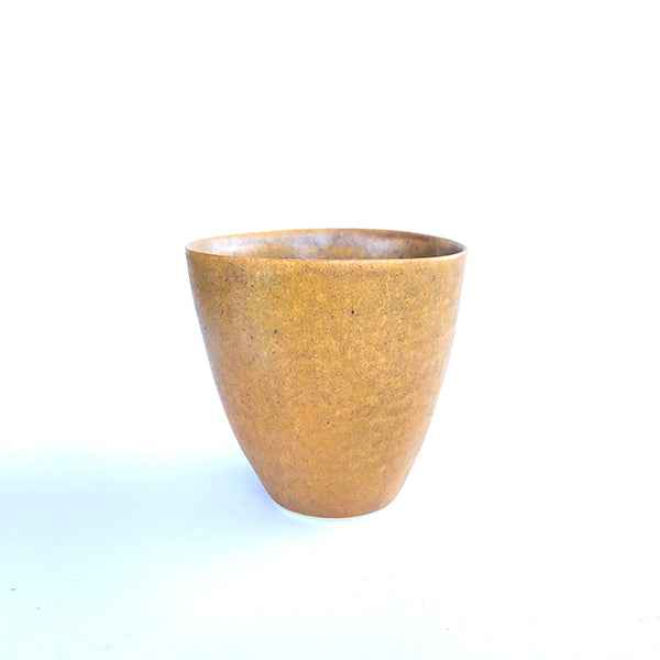 handmade ceramic yellow colour tea and coffee cup or water cup at hippist