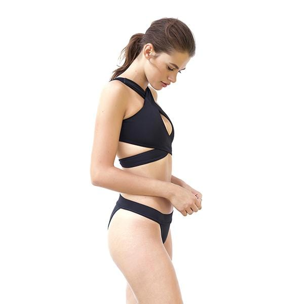 a woman with wrap top movom branded black bikini