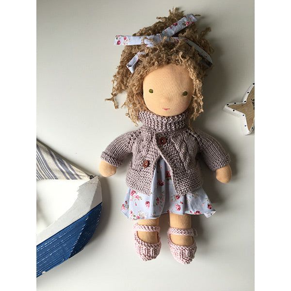 Soft organic waldorf doll with blonde hair, wool lilac cardigan and blue flower printed cotton dress
