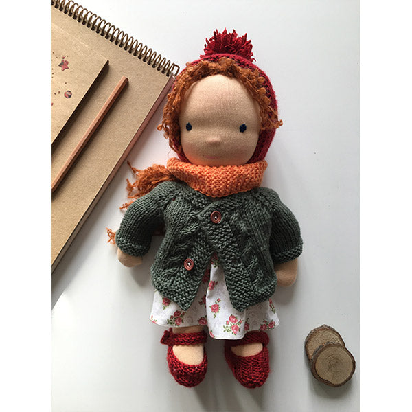 Soft organic waldorf doll with red hair, dark green wool cardigan and lilac flower printed cotton dress