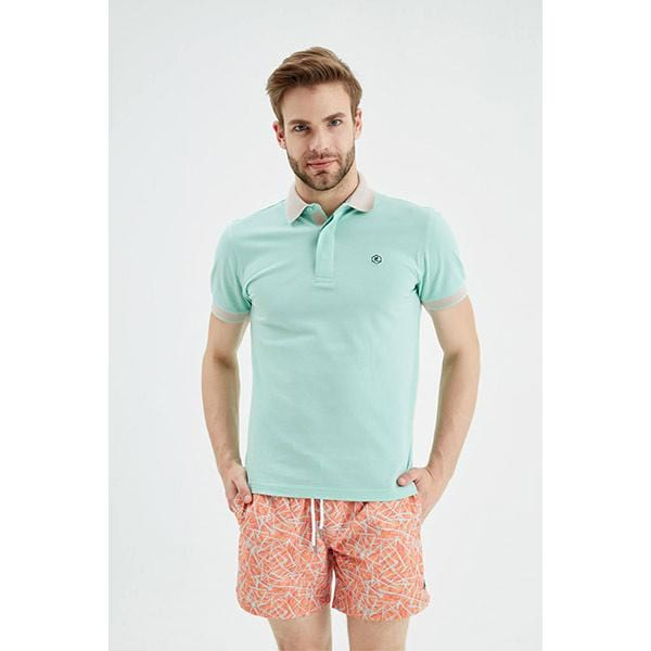 A man with patterned men orange swim shorts and blue t-shirt
