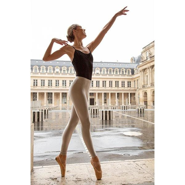 ballerina dancing with beige leggings and black top in paris streets