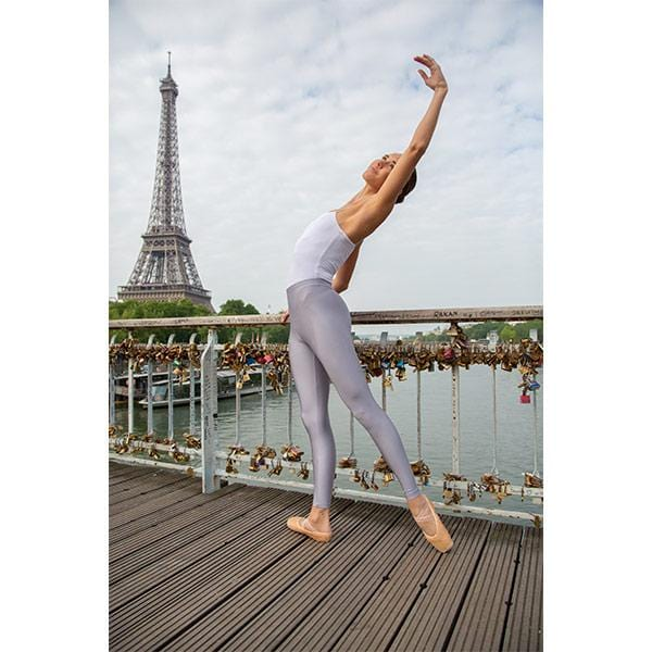 ballerina dancing with lavender leggings and white top in front of Eiffel tower in Paris