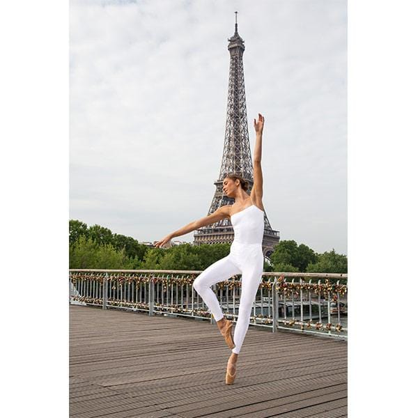 ballerina dancing with white leggings and white top in front of Eiffel Tower in Paris