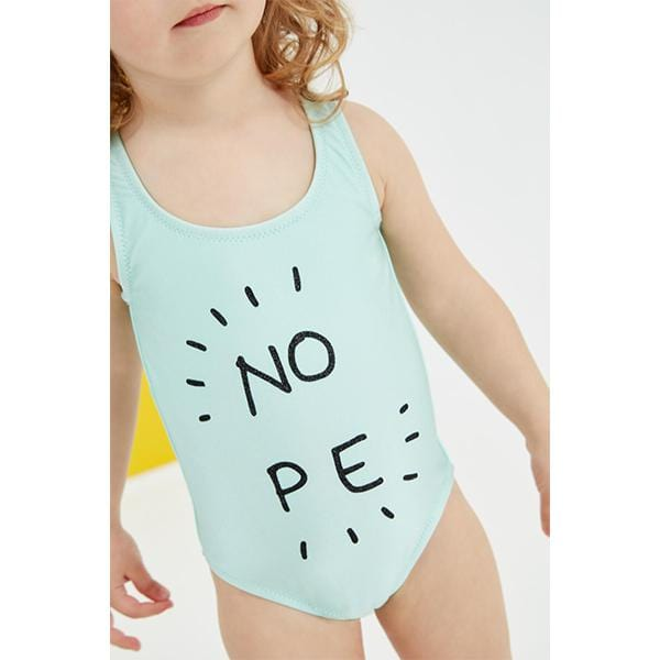 Green swimsuit with 'Nope' slogan black glitter print detail