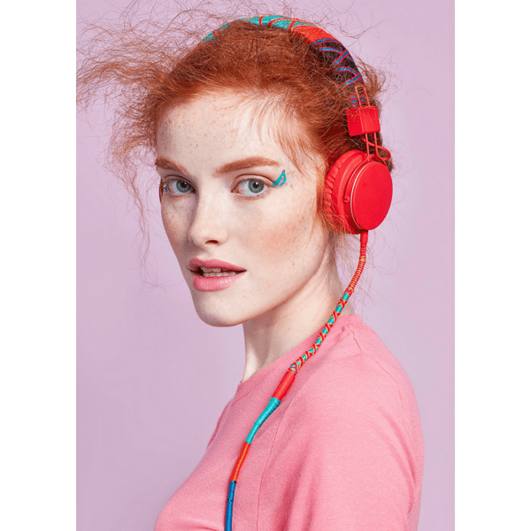 Girl looking us with colorful headphones handcrafted on Urbanears Plattan 2 headphones