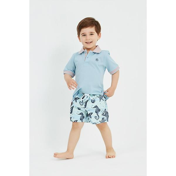 Little boy with underwater patterned swim shorts