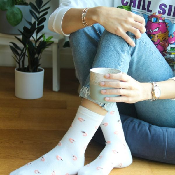 A girl with Fundaze branded white bamboo socks with Shrimp pattern