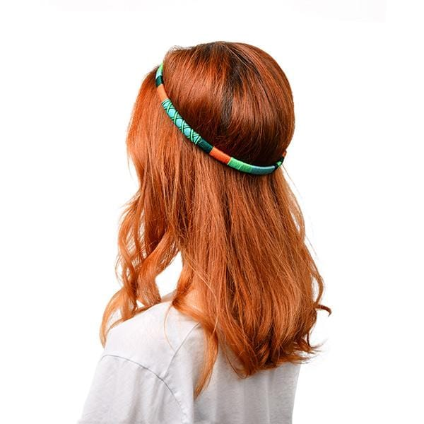a girl with orange hair wears multicolors happy-nes branded headband
