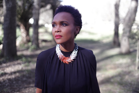 Image of Lungi Morrison Wearing a Thousand Hills Necklace in Copper and Silver