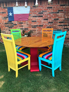 Refurbished solid oak dining table and serape chairs