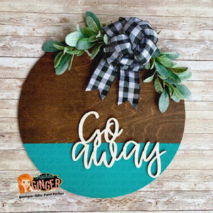 Go Away walnut stained round with buffalo check and lamb's ear wooden sign