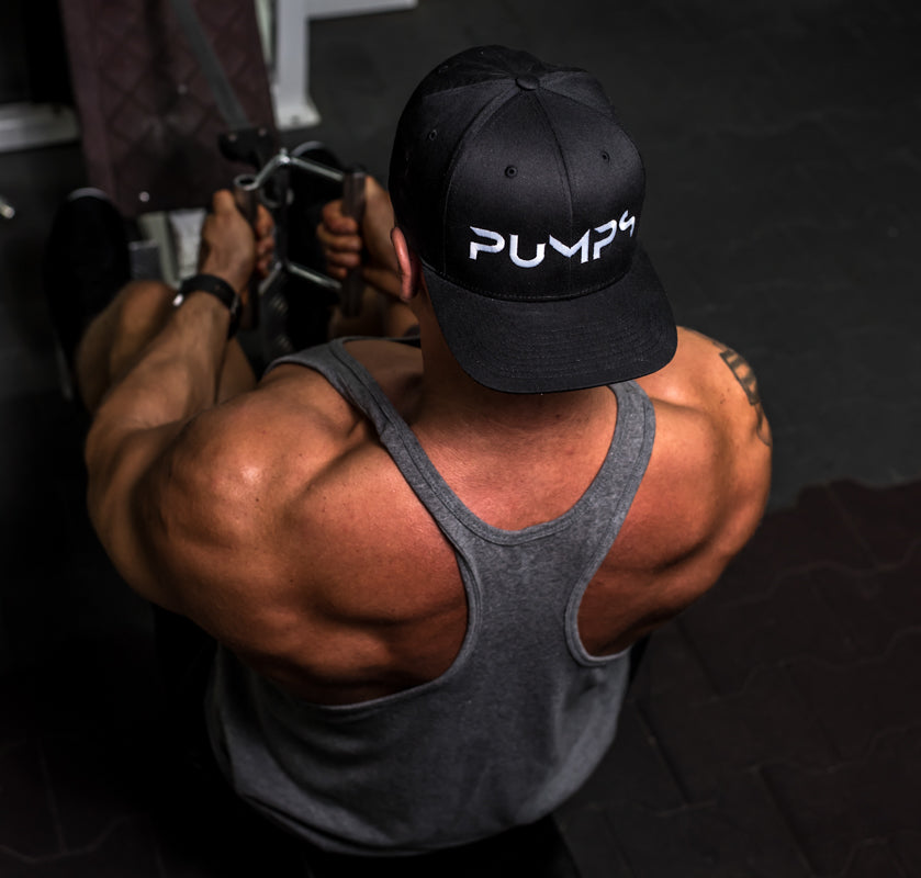 Bodybuilder doing a back workout wearing a PUMPS flexfit hat from Northern Sports Nutrition, A Canadian supplement company specializing in Pre-workouts, Protein Isolate powders, Fat Burners, BCAAs, And organ defenders with liver protection