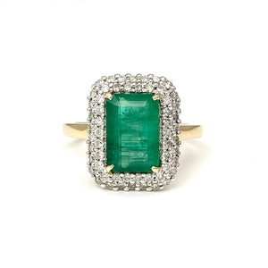 14K Yellow Gold and Rhodium Emerald Ring Surrounded by Diamonds