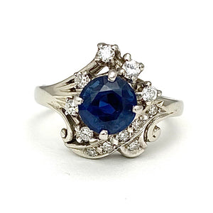 18K White Gold Ring with a Sapphire Center and Diamonds