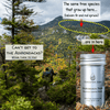 View of Adirondack forest in mountains with Forester John Essential Oil bottle.