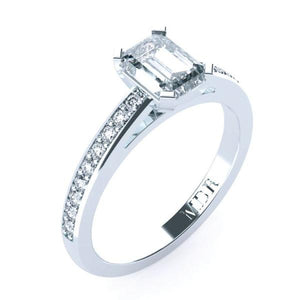 Solitaire Emerald cut diamond platinum ring