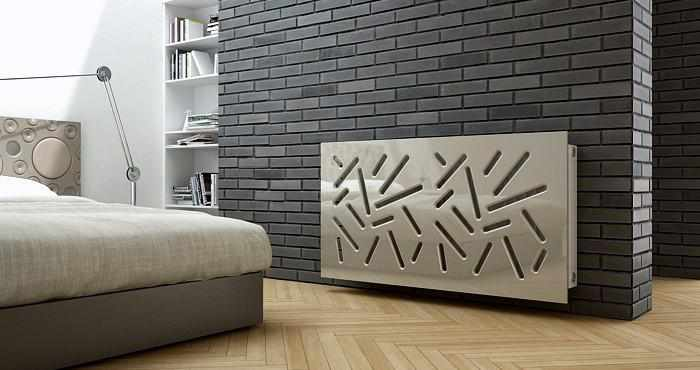 Stylish bedroom with a modern bed, lamp and a radiator cover on a grey brick wall