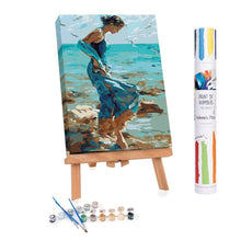 Adults paint by numbers of a woman walking on the beach at low tide